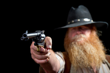 Cowboy holding his pistol about to shoot