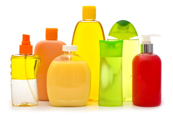 Composition of shampoo bottles and soap dispensers on white