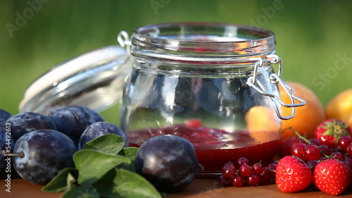 Jar with fresh jam and fruits