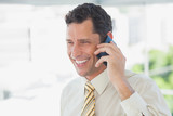 Laughing businessman on the phone