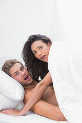 Couple caught in the act in bed
