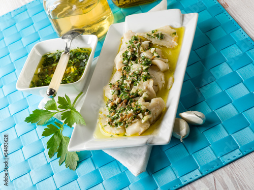 cod fillet  marinated with parsley anchovy and garlic
