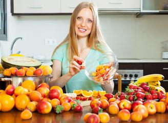 blonde woman cooking fruit salad