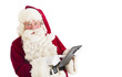 Portrait Of Santa Claus Using Digital Tablet