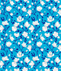 Seamless blue pattern with a blossoming magnolia