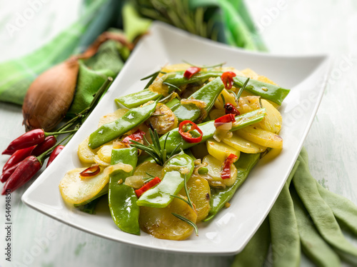 potatoes salad with flat green beans, selective focus