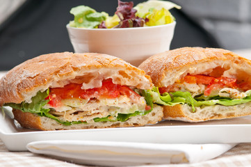 ciabatta panini sandwich with chicken and tomato