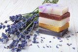 Natural handmade soap stack with lavender on wooden table