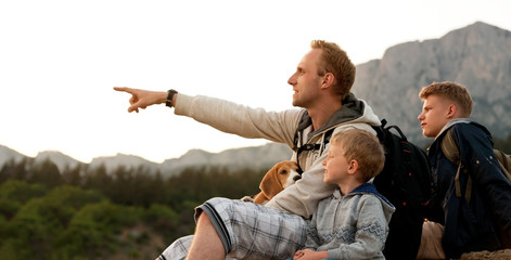 Father with sons on the mountain walk