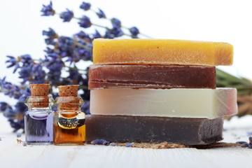Handmade soap with lavender and essential oil on wooden table