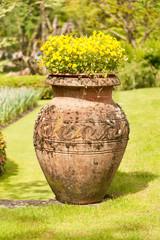 Earthenware jug with flowers in garden of Villa Taranto, Italy