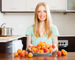blonde housewife with fresh apricots