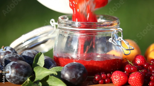Jar with fresh homemade jam and fruits