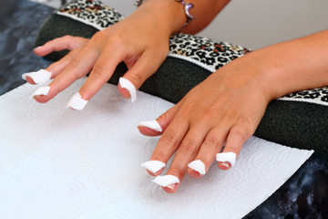 Womans hands prepared to professional manicure