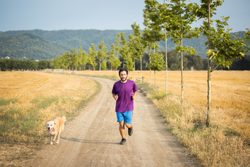 Guy running with a dog