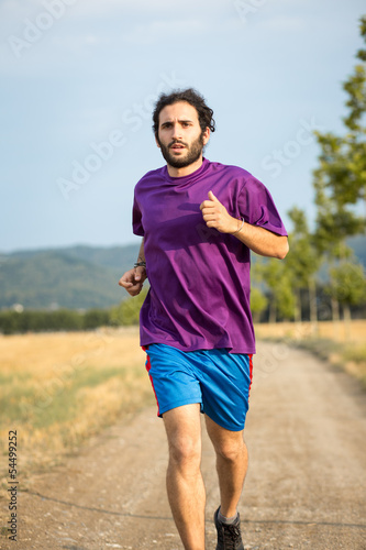 Young man running in the nature