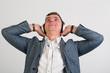 Cheerful man wearing headphones looking up