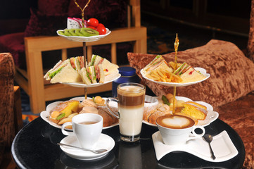 Afternoon tea with sandwiches and coffee