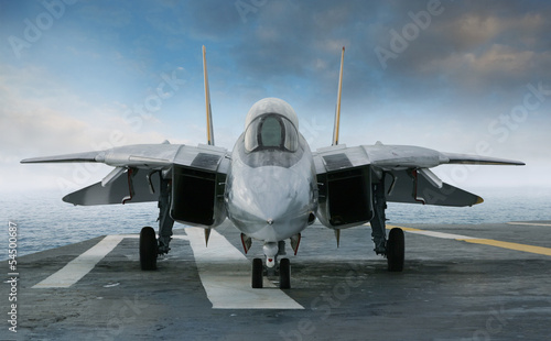 canvas print picture F-14 jet fighter on an aircraft carrier deck viewed from front