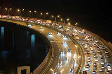 Night traffic on highway with motion cars