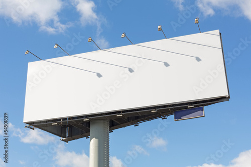 Advertising billboard on a background of blue sky