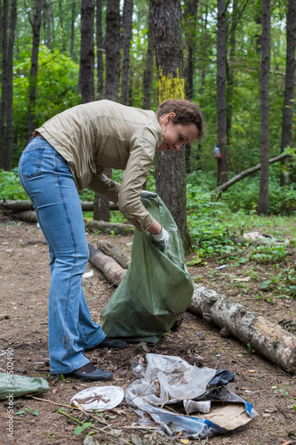 Girl helping clean up the forest