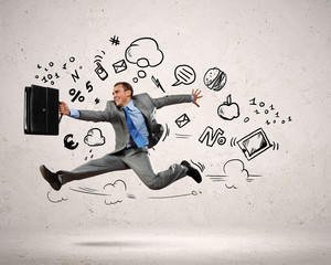 Jumping young businessman
