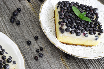 Blueberry fruitcake on wooden background