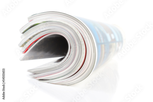 Group of twisted magazine. Close-up on a white background.