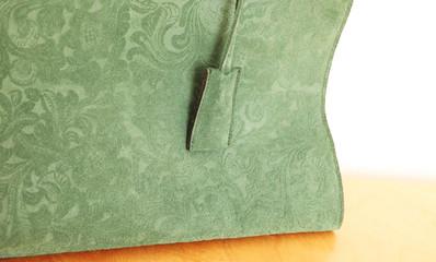 grüne Tasche im Detail