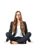 Young business woman with glasses sitting on floor