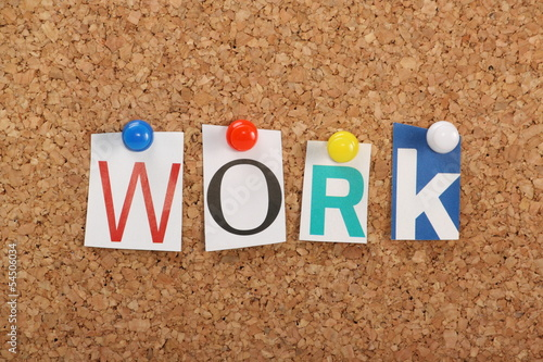 The word Work on a cork notice board