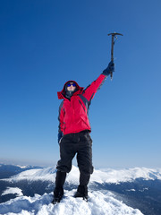 Mountain climber on the top. Sport and active life