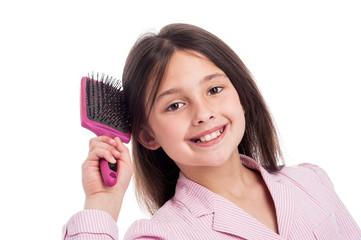 Beautiful Young Girl Brushinhg Hair.