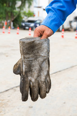 Dirty leather gloves
