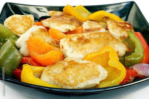 Poster Closeup of roasted fish & capsicum