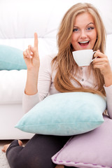 woman having idea with cup