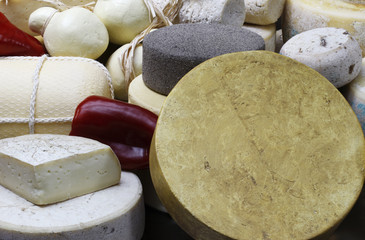 various cheeses on display