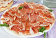 Plate with slices of ham