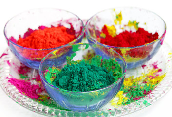 Vivid color gulal kept in a bowl focus on green