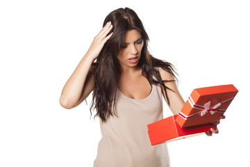 pretty girl is not happy and surprised by her gift