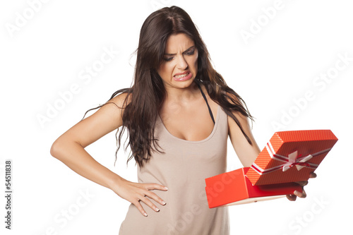 pretty girl is not happy and is disgusted her gift