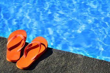 .sandals by a pool