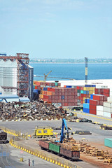 Cargo container, lumber and train in port Odessa, Ukraine