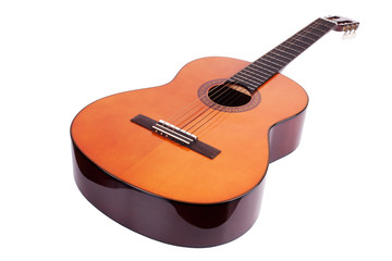 Wooden acoustic guitar on white background