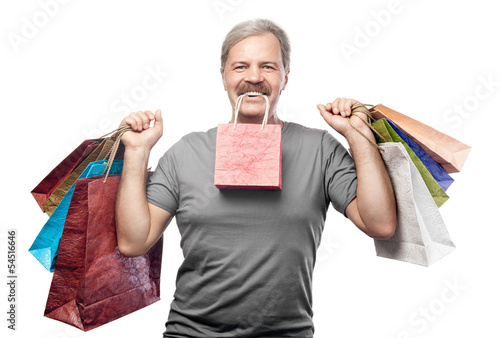 smiling mature man holding shopping bags isolated on white backg