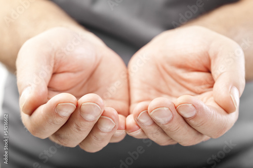 two male hands as if giving, showing or holding concept