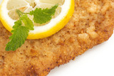 Viennese Schnitzel with lemon and lemon balm leaf
