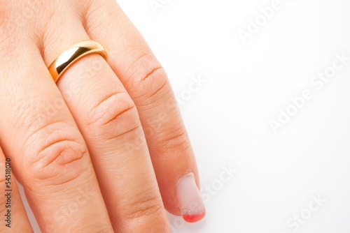 detail of one hand with gold ring with space for text