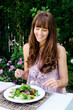 Healthy eating lifestyle woman having salad outdoors